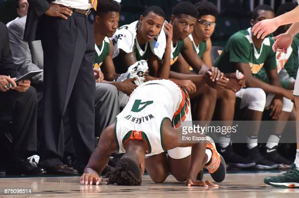 Lonnie Walker IV of the Miami Hurricanes is on the floor with an injury during the first half against the Florida AM Rattlers at BankUnited Center on...