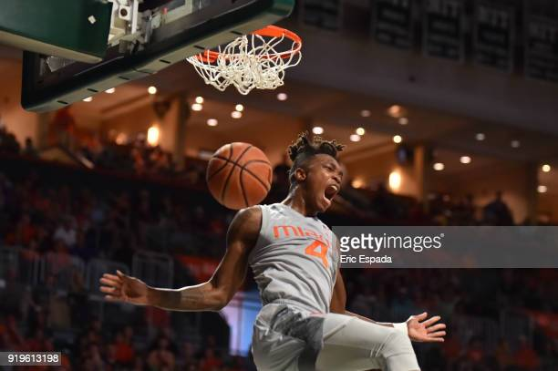 Lonnie Walker IV of the Miami Hurricanes reacts after dunking the basketball during the second half of the game against the Syracuse Orange at The...