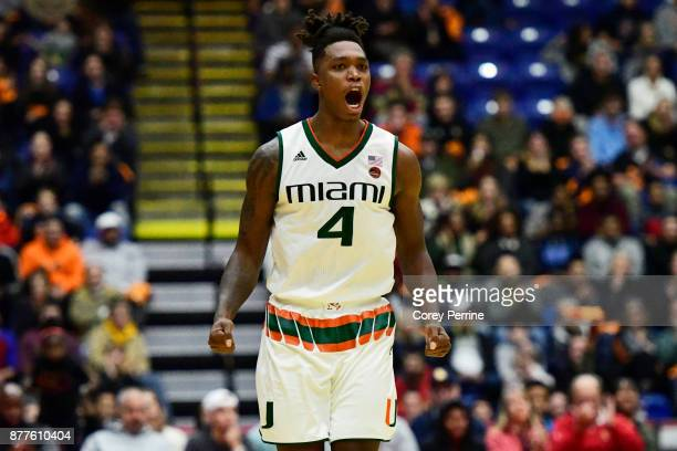 Lonnie Walker IV of the Miami Hurricanes reacts to his score against the La Salle Explorers during the second half at Santander Arena on November 22...