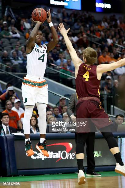 Lonnie Walker IV of the Miami Hurricanes shots over Bruno Skokna of the Loyola Ramblers in the first half in the first round of the 2018 NCAA Men's...