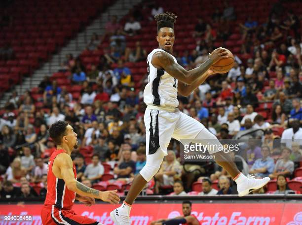Lonnie Walker IV of the San Antonio Spurs catches a pass against Chris Chiozza of the Washington Wizards during the 2018 NBA Summer League at the...