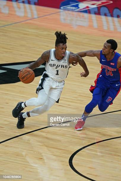 Lonnie Walker IV of the San Antonio Spurs dribbles the ball against the Detroit Pistons during a preseason game at ATT Center in San Antonio Texas on...