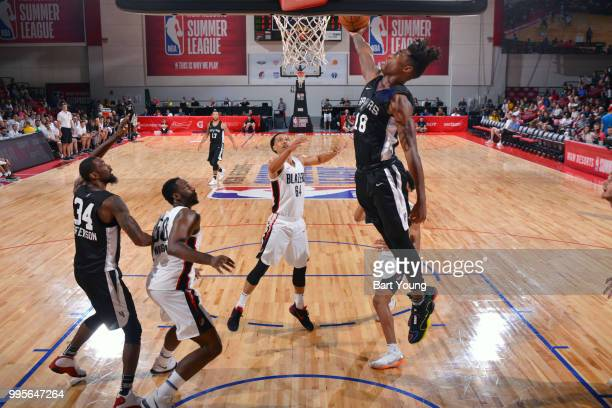 Lonnie Walker IV of the San Antonio Spurs goes to the basket against the Portland Trail Blazers during the 2018 Las Vegas Summer League on July 10...