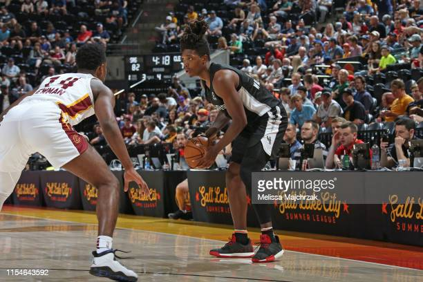 Lonnie Walker IV of the San Antonio Spurs handles the ball during the game against Malik Newman of the Cleveland Cavaliers on July 1 2019 at...