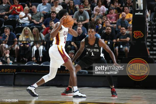 Lonnie Walker IV of the San Antonio Spurs plays defense against during the game against Malik Newman of the Cleveland Cavaliers on July 1 2019 at...