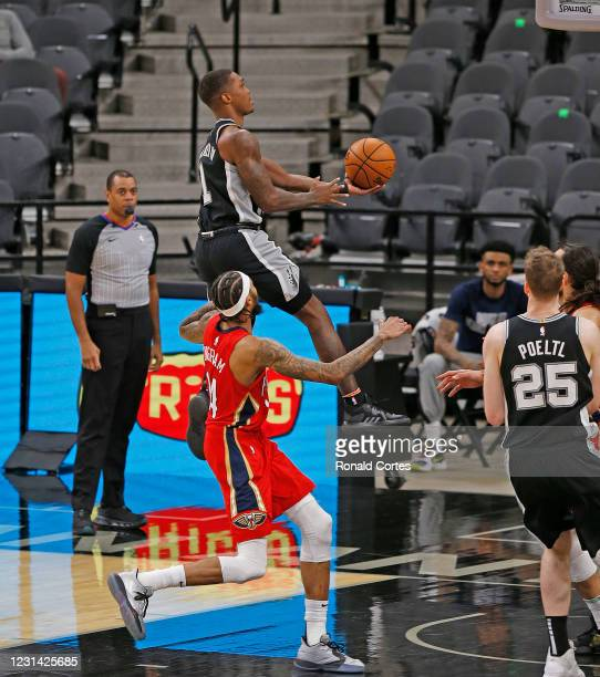 Lonnie Walker of the San Antonio Spurs drives past Brandon Ingram of the New Orleans Pelicans in the second half at AT&T Center on February 27, 2021...