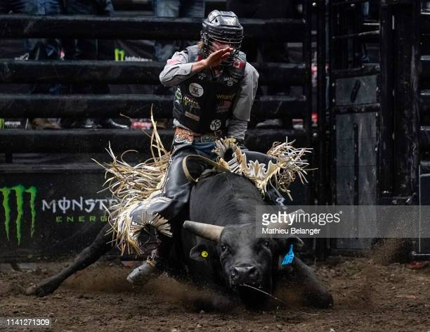 Lonnie West of Canada rides Party Vibrations during the PBR Monster Energy Tour Professional Bull Riders event at Videotron Centre on May 4, 2019 in...
