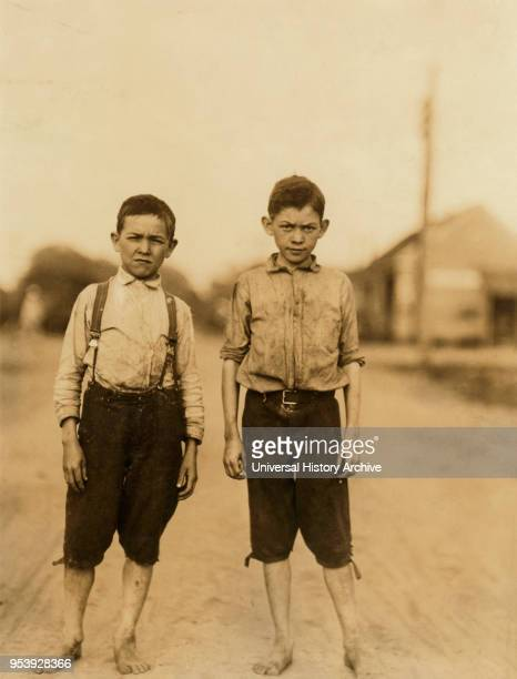 Lonny and Dewey Clark Two Young Brothers Work as Spinners in Spinning Room of Textile Mill FullLength Portrait Columbus Georgia USA Lewis Hine for...