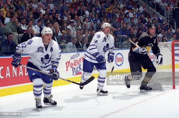 Lonny Bohonos and Steve Thomas of the Toronto Maple Leafs skate against Kevin Hatcher of the Pittsburgh Penguins during the 1999 Quarter Finals of...