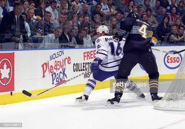 Lonny Bohonos of the Toronto Maple Leafs skates against Kevin Hatcher of the Pittsburgh Penguins during the 1999 Quarter Finals of the NHL playoff...