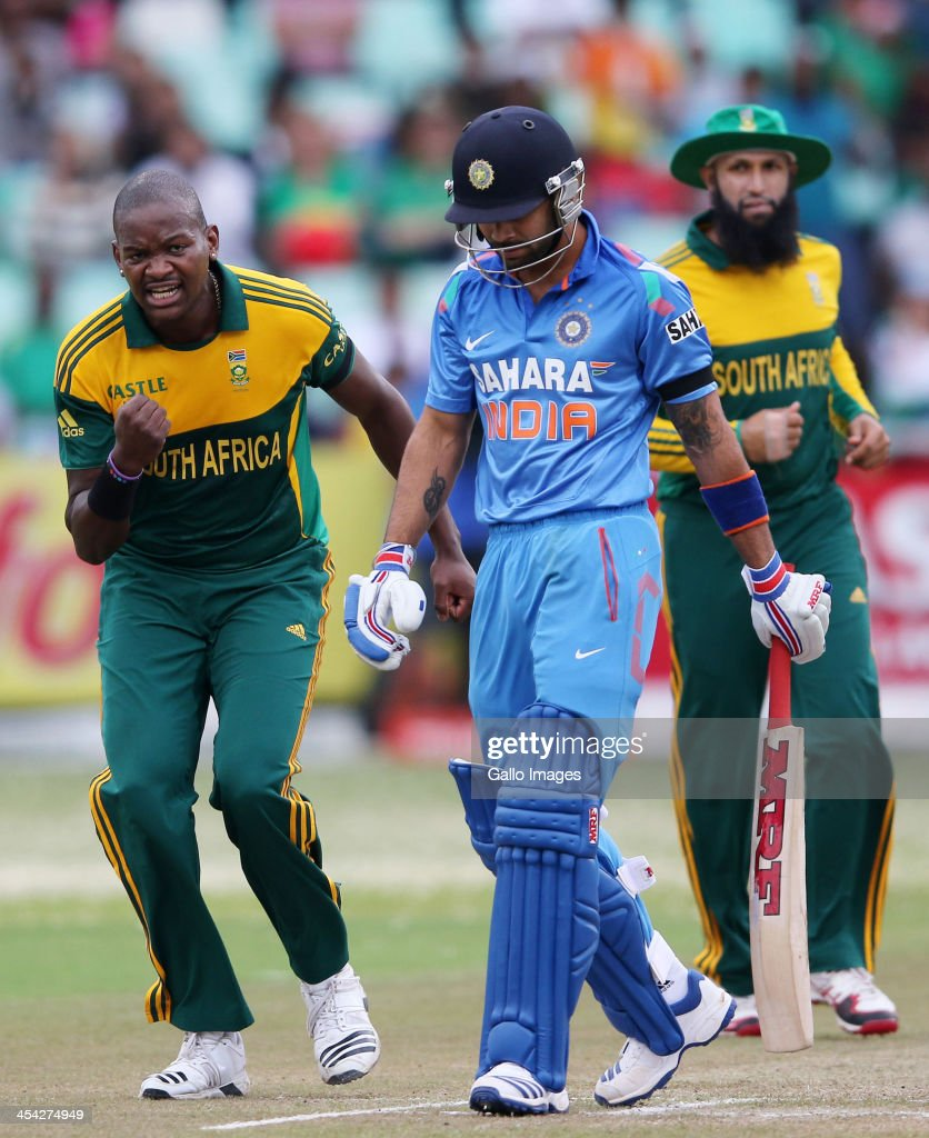 Lonwabo Tsotsobe celebrates Virat Kohli's wicket during the 2nd Momentum ODI match between South Africa and India at Sahara Stadium Kingsmead on December 08, 2013 in Durban, South Africa.