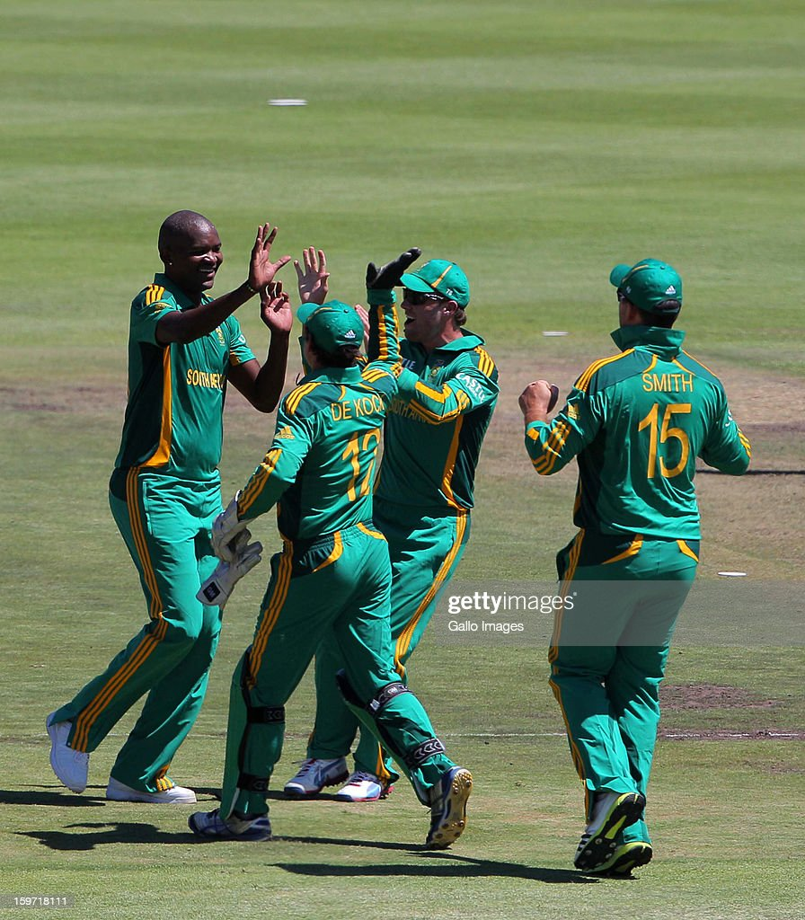 Lonwabo Tsotsobe (L) of South Africa celebrates a wicket during the 1st One Day International match between South Africa and New Zealand at Boland Park on January 19, 2013 in Paarl, South Africa.