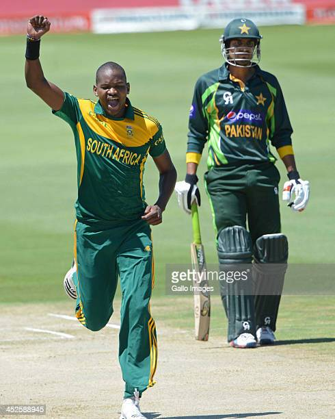 Lonwabo Tsotsobe of South Africa celebrates the wicket of Asad Shafiq of Pakistan during the 3rd One Day International match between South Africa and...