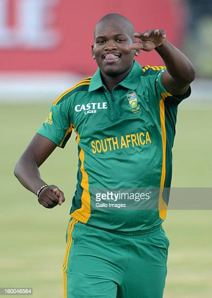Lonwabo Tsotsobe of South Africa celebrates the wicket of Grant Elliott of New Zealand during the 3rd One Day International match between South...