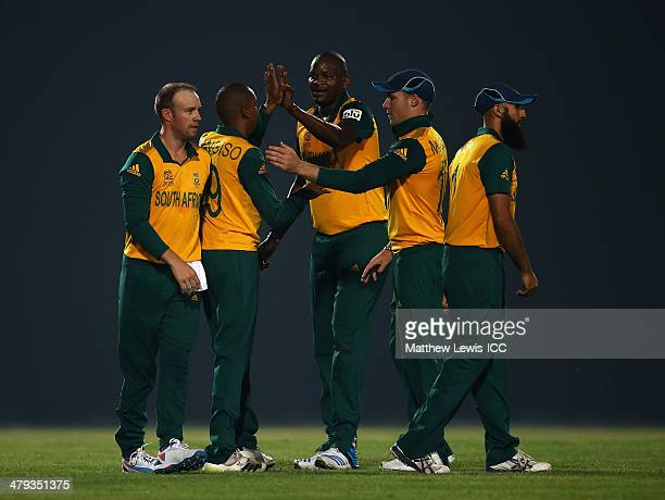 Lonwabo Tsotsobe of South Africa celebrates the wicket of Mithun Ali of Bangladesh A after he was caught by Aaron Phangiso during the ICC World...