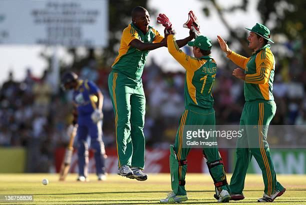Lonwabo Tsotsobe of South Africa celebrates with team mates AB de Villiers and Graeme Smith after claiming the wicket of Tillakaratne Dilshan of Sri...