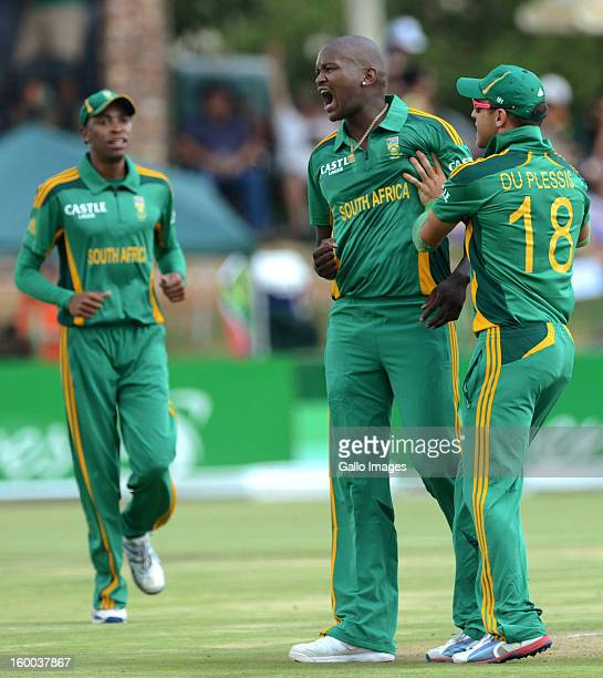 Lonwabo Tsotsobe of South Africa celebrates with teammate Faf du Plessis after claiming the wicket of Martin Guptill during the 3rd One Day...