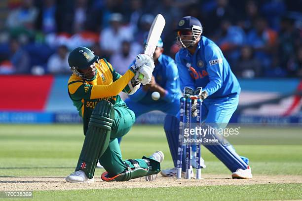 Lonwabo Tsotsobe of South Africa is bowled by Ravindra Jadeja as MS Dhoni looks on behind the stumps during the Group B ICC Champions Trophy match...