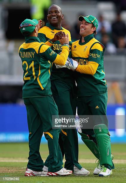 Lonwabo Tsotsobe of South Africa is congratulated by team mates after catching and bowling Nasir Jamshed of Pakistan during the ICC Champions Trophy...