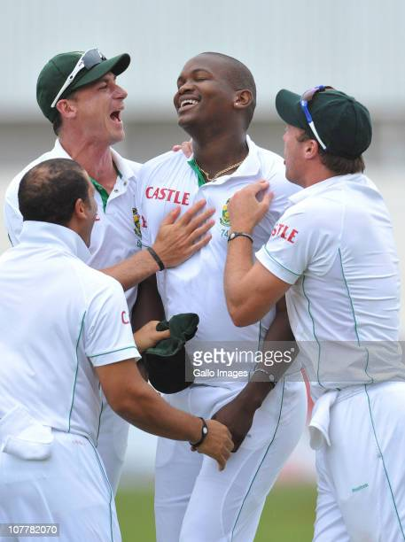 Lonwabo Tsotsobe of South Africa is congratulated by teammates Dale Steyn AB de Villiers and Ashwell Prince after taking the wicket of Sachin...