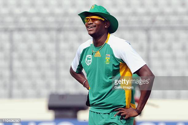 Lonwabo Tsotsobe of South Africa smiles during the South African national cricket team nets session at the Outer field SBNCS in Mirpur on March 18...