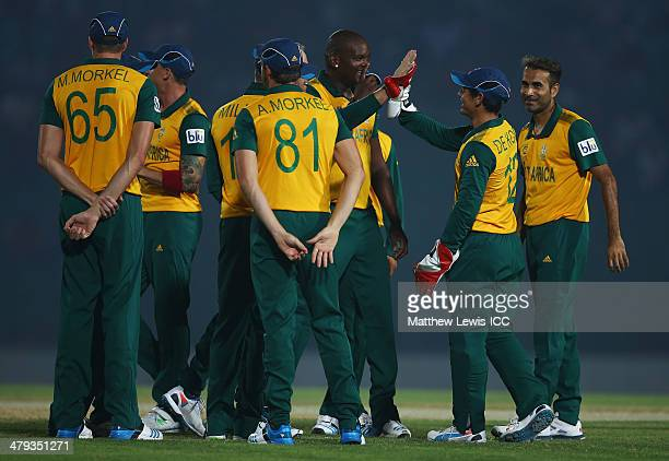 Lonwabo Tsotsobe of South Africacelebrates the wicket of Imrul Kayes of Bangladesh A after he was caught by Quinton de Kock during the ICC World...
