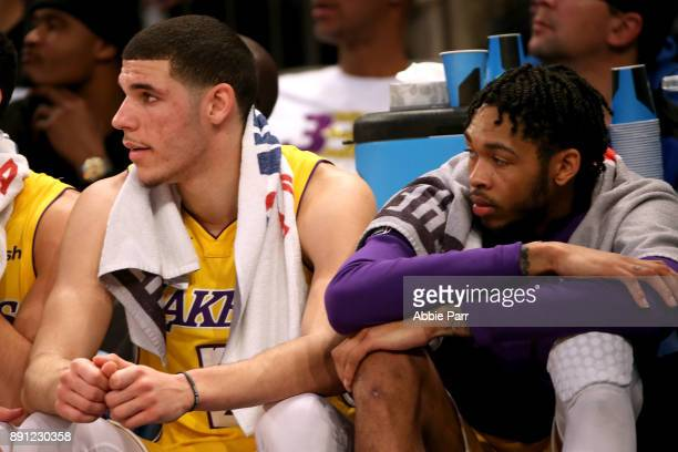 Lonzo Ball and Brandon Ingram of the Los Angeles Lakers watch play from the bench in the first half during their game at Madison Square Garden on...
