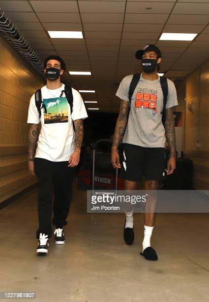 Lonzo Ball and Brandon Ingram of the New Orleans Pelicans exits after the game against the San Antonio Spurs as part of the NBA Restart 2020 on...