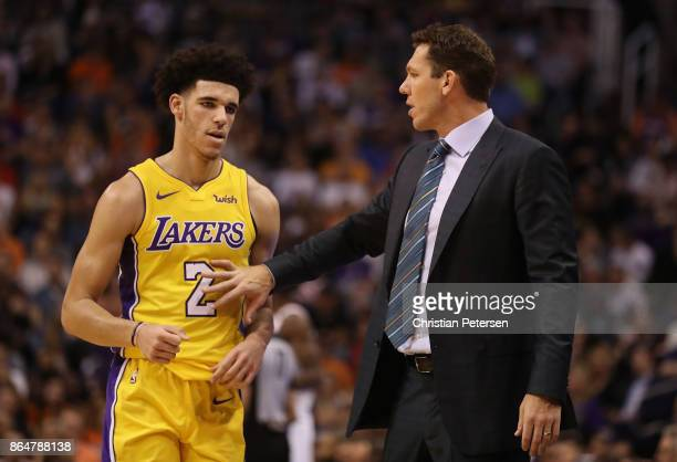 Lonzo Ball and head coach Luke Walton of the Los Angeles Lakers talk during the first half of the NBA game against the Phoenix Suns at Talking Stick...