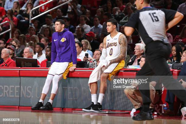 Lonzo Ball and Kyle Kuzma of the Los Angeles Lakers look on during the game against the Houston Rockets on December 20 2017 at Toyota Center in...