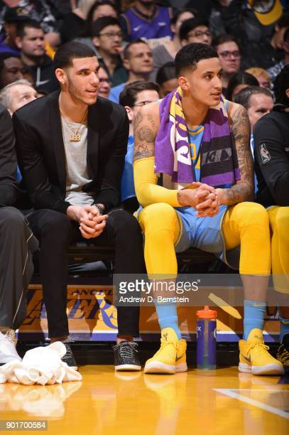 Lonzo Ball and Kyle Kuzma of the Los Angeles Lakers look on during the game against the Oklahoma City Thunder on January 3 2018 at STAPLES Center in...