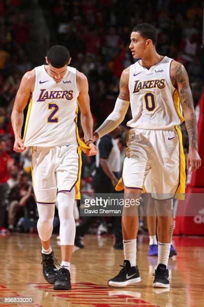 Lonzo Ball and Kyle Kuzma of the Los Angeles Lakers walk off the court after halftime of the game against the Houston Rockets on December 20 2017 at...
