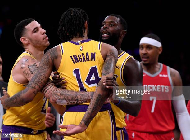 Lonzo Ball and Lance Stephenson of the Los Angeles Lakers restrain Brandon Ingram from Carmelo Anthony of the Houston Rockets during a 124115 loss to...