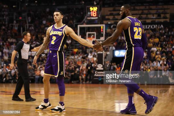 Lonzo Ball and LeBron James of the Los Angeles Lakers high five during the first half of the NBA game against the Phoenix Suns at Talking Stick...