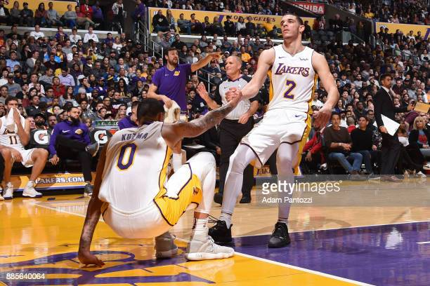 Lonzo Ball helps up Kyle Kuzma of the Los Angeles Lakers during the game against the Houston Rockets on December 3 2017 at STAPLES Center in Los...
