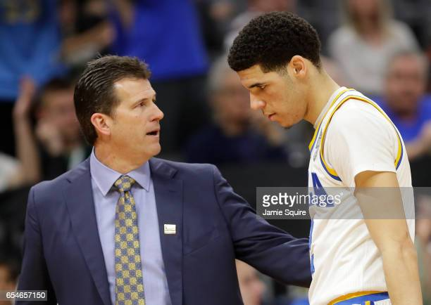 Lonzo Ball is congratulated by his Head coach Steve Alford of the UCLA Bruins as his team defeats the Kent State Golden Flashes during the first...