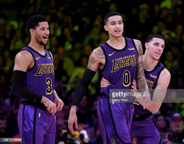 Lonzo Ball Kyle Kuzma and Josh Hart of the Los Angeles Lakers joke during a 114103 win over the Dallas Mavericks at Staples Center on November 30...