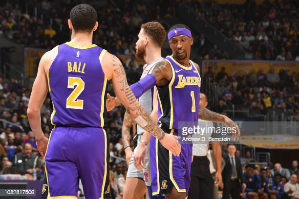 Lonzo Ball of the Los Angeles Lakers and Kentavious CaldwellPope of the Los Angeles Lakers celebrate during the game against the Detroit Pistons on...