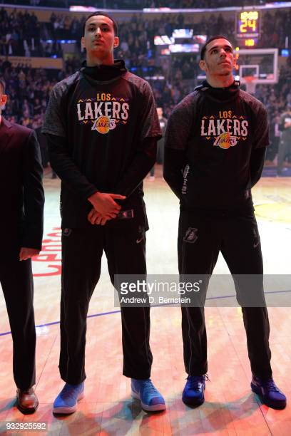 Lonzo Ball of the Los Angeles Lakers and Kyle Kuzma of the Los Angeles Lakers during the national anthem before the game against the Orlando Magic at...