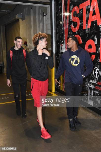 Lonzo Ball of the Los Angeles Lakers and LaMelo Ball arrives at the arena before the game against the Golden State Warriors on November 29 2017 at...