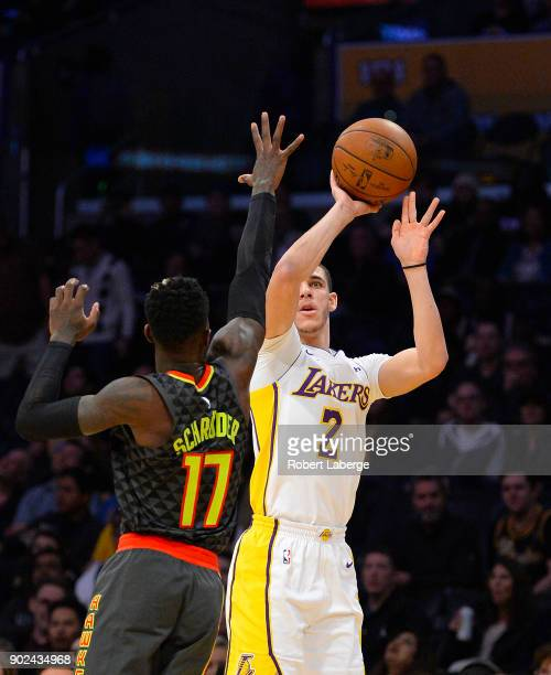 Lonzo Ball of the Los Angeles Lakers attempts a jump shot against Dennis Schroder of the Atlanta Hawks on January 7 2018 at STAPLES Center in Los...