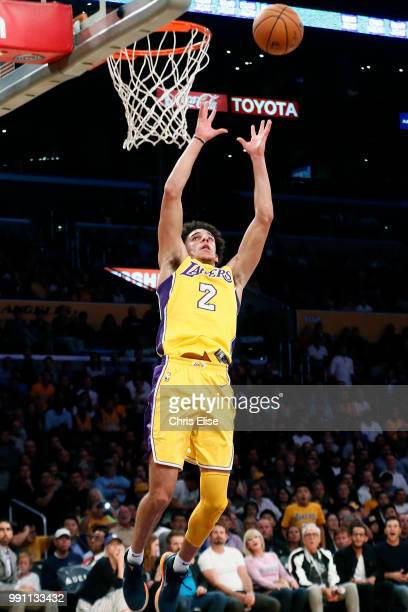Lonzo Ball of the Los Angeles Lakers catches the rebound against the Denver Nuggets on October 2 2017 at the Staples Center in Los Angeles California...