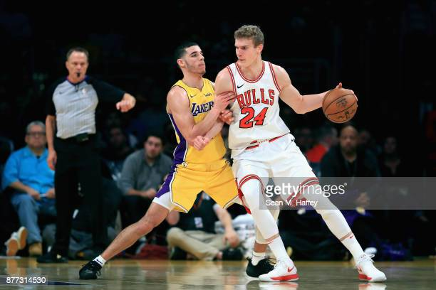 Lonzo Ball of the Los Angeles Lakers defends against Lauri Markkanen of the Chicago Bulls during the second half of a game at Staples Center on...