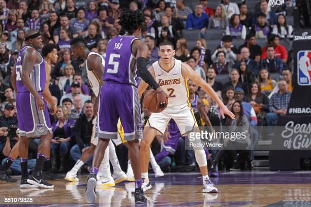 Lonzo Ball of the Los Angeles Lakers defends De'Aaron Fox of the Sacramento Kings on November 22 2017 at Golden 1 Center in Sacramento California...
