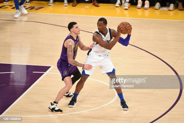 Lonzo Ball of the Los Angeles Lakers defends Harrison Barnes of the Dallas Mavericks on November 30 2018 at STAPLES Center in Los Angeles California...