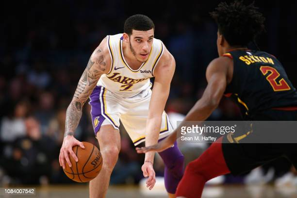 Lonzo Ball of the Los Angeles Lakers dribbles as Collin Sexton of the Cleveland Cavaliers defends during the first half of a game at Staples Center...