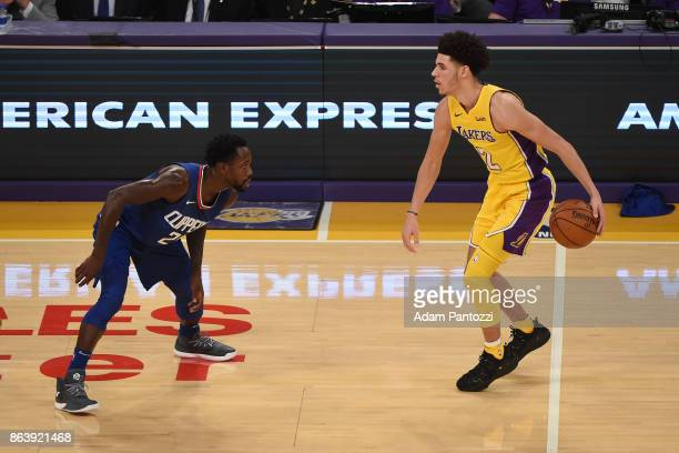 Lonzo Ball of the Los Angeles Lakers dribbles the ball against Patrick Beverley of the LA Clippers on October 19 2017 at STAPLES Center in Los...