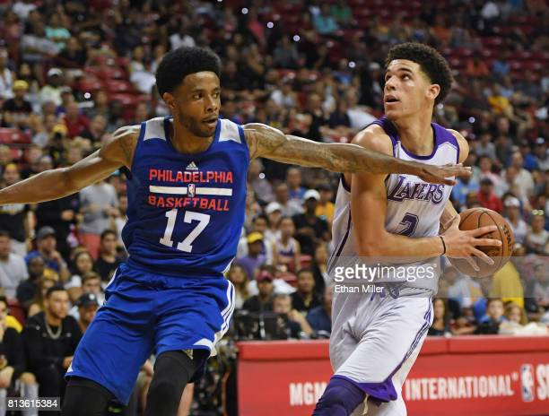 Lonzo Ball of the Los Angeles Lakers drives to the basket against Larry Drew II of the Philadelphia 76ers during the 2017 Summer League at the Thomas...