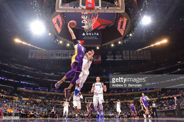 Lonzo Ball of the Los Angeles Lakers dunks the ball during the game against the Dallas Mavericks on March 28 2018 at STAPLES Center in Los Angeles...