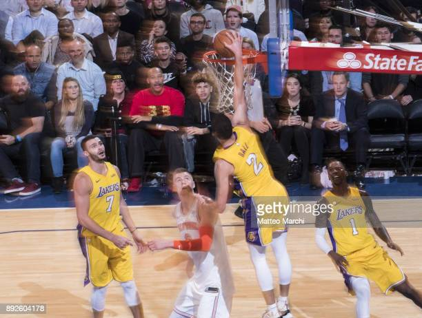 Lonzo Ball of the Los Angeles Lakers dunks the ball while the father LaVar Ball is watching on the sideline during the game against the New York...